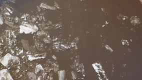 The ice floes floating on the river. The ice drift in spring time. Aerial footage of the ice drift in spring time. The ice floes floating on the river stock video footage