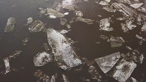 The ice floes floating on the river. The ice drift in spring time. Aerial footage of the ice drift in spring time. The ice floes floating on the river stock footage