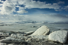 Ice floes in front of frozen lake Royalty Free Stock Images