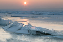 Ice floes on the frozen lake Stock Photo