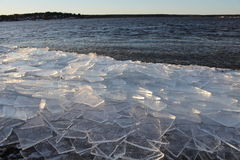 Ice floes in the Lule River. Ice floes that have been blown ashore on the beach after November storm Stock Photo