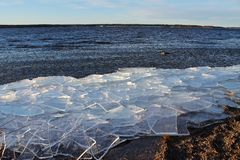 Ice floes in the Lule River. Ice floes that have been blown ashore on the beach after November storm Stock Images