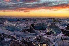 Ice floes on raging heavy sea at the shore of North Atlantic Ocean at the famous glacier lagoon in Vatnajokull National Park,. Raging heavy sea and winter storm stock photography