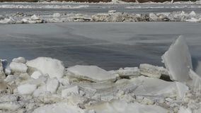 Ice floes on river. Large ice floes floating on the river surface stock footage