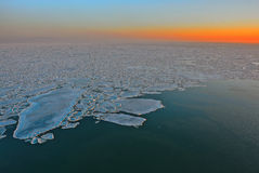 Ice floes at sunset Royalty Free Stock Images