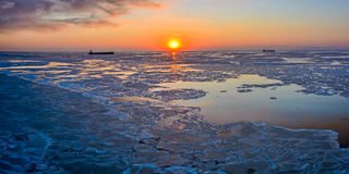Ice floes at sunset Stock Photo