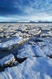 Ice Flow into the Horizon. HDR image of sea ice on Kachemak Bay, Alaska with Kenai mountains in the background Stock Photos