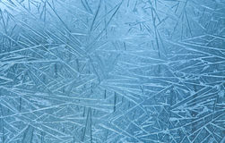 Ice flowers. Frost lines in frozen winter window. Stock Photo