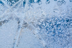 Ice flowers and frozen dirty window macro view. Frost texture pattern. Winter scene. soft focus. Photo Stock Image