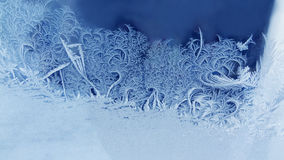 Ice flowers frozen window background. macro view photography frost textured pattern. cold winter weather xmas concept. Shallow depth field Stock Image