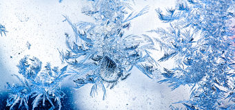 Ice flowers on window stock photo
