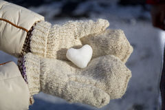 Ice in the form of heart in his hands Stock Photo
