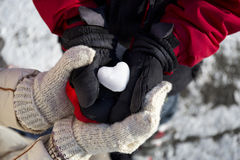 Ice in the form of heart in his hands Royalty Free Stock Photos
