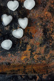 Ice in form of hearts on black background starting to melt. Stock Image