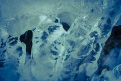 Ice formation in blue, winter theme, wallpaper. Ice formation in winter, blue colored, wallpaper, background stock photos