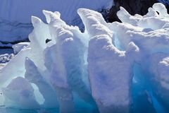 Ice formation floating around Melchior Islands, Antarctic Peninsula, Antarctica. Melting ice formation during the summer season amidst Melchior Islands Stock Photo