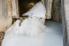 Ice formation at mouth of culvert. Ice formation at mouth of concrete culvert of flowing water royalty free stock photos