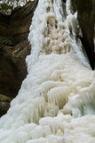 Ice formations on the frozen falls. Stock Photos
