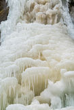 Ice formations on the frozen falls. Royalty Free Stock Images