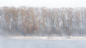 Ice formations on the river. Rising the fog stock footage