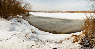 Ice fragments under thin layer of frozen river water. Royalty Free Stock Photo
