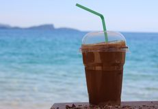 Ice frappe on the beach with straw Stock Photo