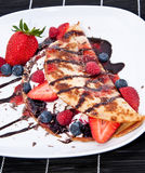 Ice in fresh Pan Cake with fruits. Ice in fresh Pan Cake with mixed fruits on black background Royalty Free Stock Photo