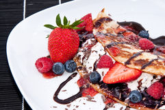 Ice in fresh Pan Cake with fruits. Ice in fresh Pan Cake with mixed fruits on black background Stock Image
