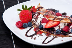 Ice in fresh Pan Cake with fruits. Ice in fresh Pan Cake with mixed fruits on black background Stock Photos