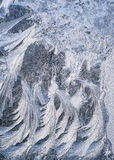 Ice frost patterns on winter glass Stock Photo