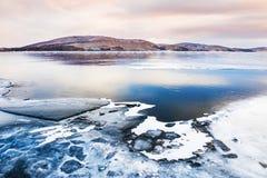 Ice on the frozen lake Stock Photos