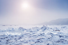 Ice on the frozen lake at sunset. Stock Image