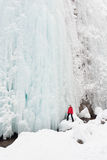 Ice frozen waterfall icefall snow girl person moutnain christmas Royalty Free Stock Photography