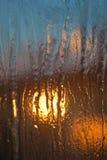 Ice of frozen window. Sunshine through transparent ice of frozen window Royalty Free Stock Photography