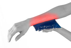 Ice gel pack on a swollen hurting wrist. Royalty Free Stock Photos