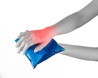 Ice gel pack on a swollen hurting wrist. Royalty Free Stock Photo