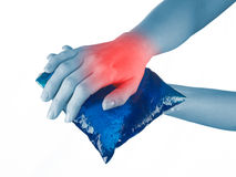 Ice gel pack on a swollen hurting wrist. Royalty Free Stock Photography