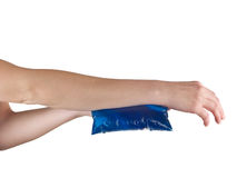 Ice gel pack on a swollen hurting wrist. Royalty Free Stock Images