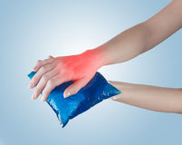 Ice gel pack on a swollen hurting wrist. Stock Photo