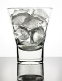 Ice in glass with reflection Stock Photo