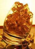 Ice in glass - warm tones I. Ice Cool Drink In Shot Glass - Granular Warm Tones Light Whiskey Royalty Free Stock Photo