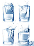 Ice in glass of water with splash set Royalty Free Stock Image