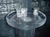 Ice glasses. Glasses made of ice on ice table Stock Images