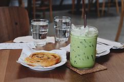 Ice green tea and Cinnamon Chip the table stock images