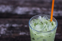 Ice green tea in glass on wood table. Stock Image
