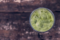 Ice green tea in glass on wood table top view. Stock Photo