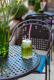 Ice green tea latte on table in cafe Royalty Free Stock Photos