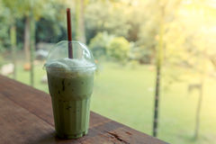 Ice green tea latte on table in cafe Royalty Free Stock Image