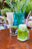 Ice green tea latte on table in cafe Stock Photography
