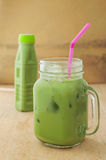 Ice green tea smoothie drink on a wooden Royalty Free Stock Image